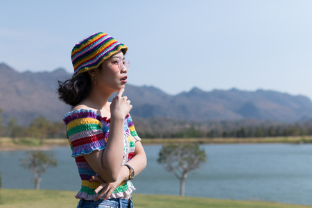 close up beauty asian woman with colorful clothes in beautiful place in nature Stock fotó