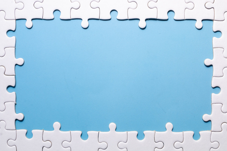 close up white jigsaw with copy space at center for add yore text on blue color background