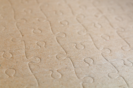 close up brown empty jigsaw board for background