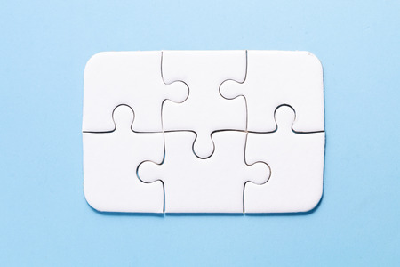 close up white color a part of jigsaw on blue color background with concept Banque d'images