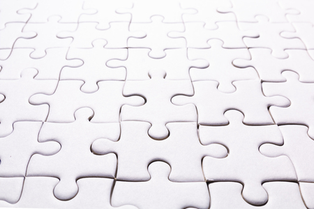 close up pattern of white jigsaw for background