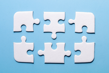 close up white color a part of jigsaw on blue color background with concept Stock fotó