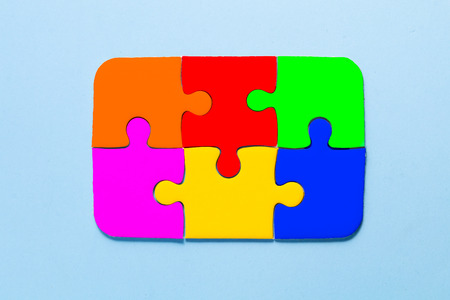 close up colorful a part of jigsaw on blue color background with concept