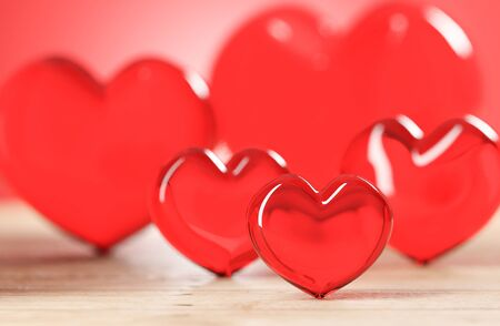 red heart candy on wooden table, love and valentine concept for background