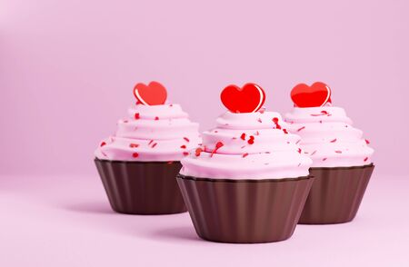 close up cupcake with pink cream and heart shape topping on pink paper color on background, love and valentine concept Stock fotó