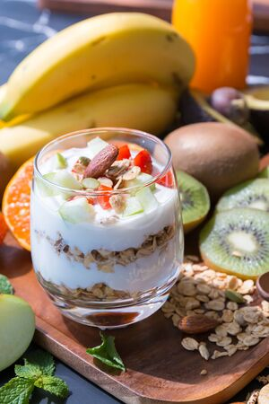 fresh fruit and yogurt in glass for healthy food