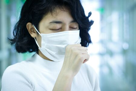 asian woman protection virus with mask on blur hospital background