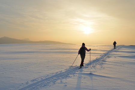 Skiers in the evening light. Stock Photo