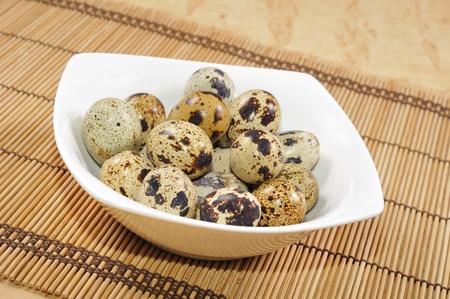 Fresh quail egg in bowl.  Stock Photo