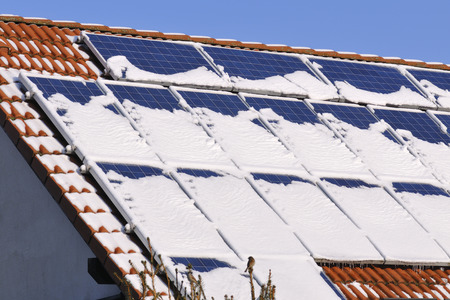 modules: Solar modules with snow in winter Stock Photo