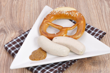 Bavarian pretzel with sausage  photo