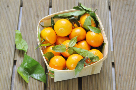 Citrus fruits against wooden background Stock Photo - 27430560
