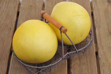 Closeup of pomelo on wooden background  Stock Photo