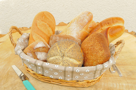 Assorted bread rolls in a bread basket  photo