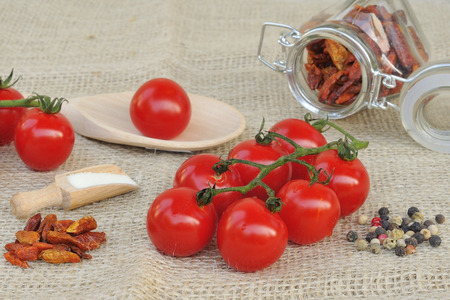 Cherry tomatoes with different spices  photo