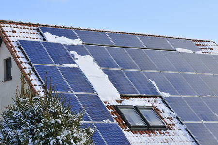 Solar modules with snow in winter, photo