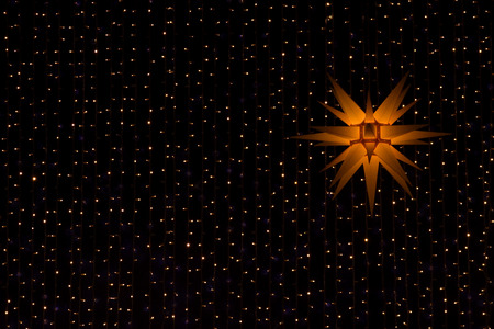 worth: Christmas star with decoration in the night