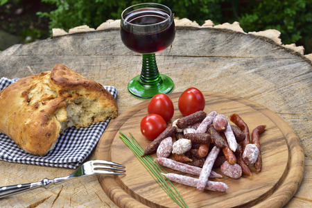 A picnic with salami, bresd and red wine Stock Photo