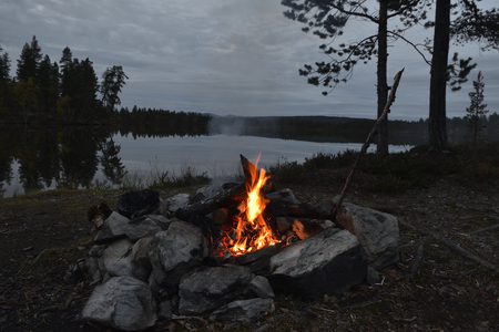 fireplace: Campfire on a evening in sweden