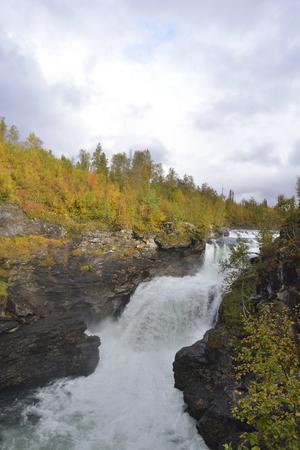 Gaustafallet waterfall in autumn in Sweden along the Vildmarksvaegen.
