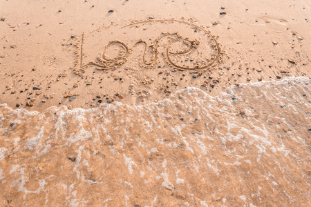 Summer drawn letters on a sandy beach. Text template pattern. Creative typography for holiday greetings. Calligraphy Font Style.