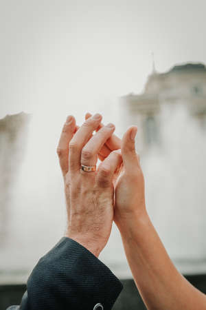 The hands of a man and a woman gently touch each other. Relationship concept Archivio Fotografico