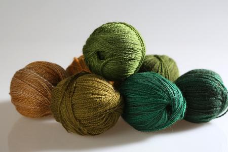 wool fiber: Handspun wool with green gradient Stock Photo