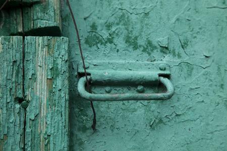 green door: the handle of the old green door