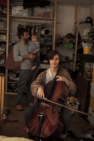 cellos: woman with the cello. the portrait of one family