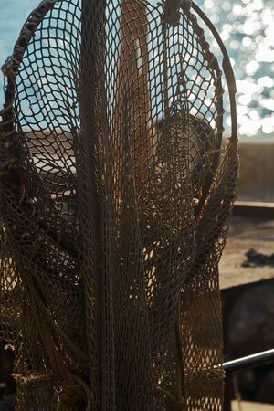 Close-up of a fishing net installed on a fishing boat