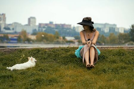 Friendship between a woman and a dog. Best friends. They do not need words.