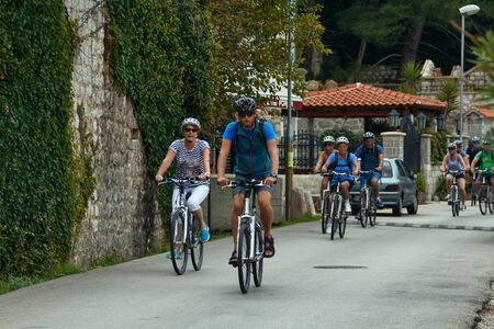 DOBROTA, MONTENEGRO, September 21, 2016: a group of older people ride bicycles.