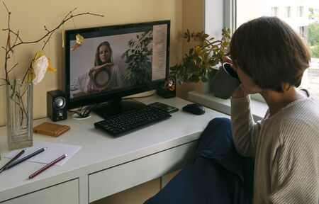 Young woman demonstrates a musical instrument for sound therapy - Strumok - on a video call.