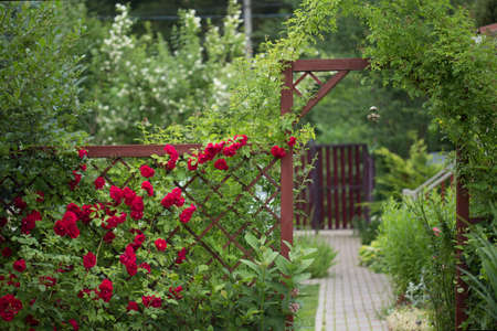 Garden landscape with red gate and hanging Chinese bell