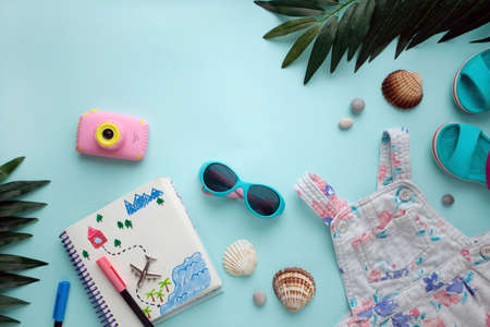 Traveling flat lay. Girl is dreaming about trips and preparing for journey, Pink and turquoise colors. Copy space. Summer dream