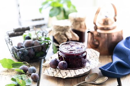 Sweet homemade plum jam and fruits on a wooden table. 写真素材 - 129477698