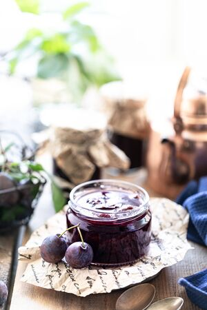 Sweet homemade plum jam and fruits on a wooden table. 写真素材 - 129477691
