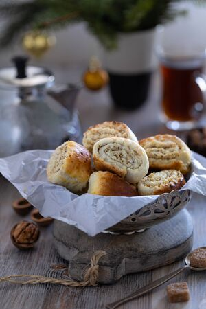 Oriental pastry made from puff pastry and wrapped in it a filling of sugar, butter and walnut. Armenian national pastry ghat with New Years serving.