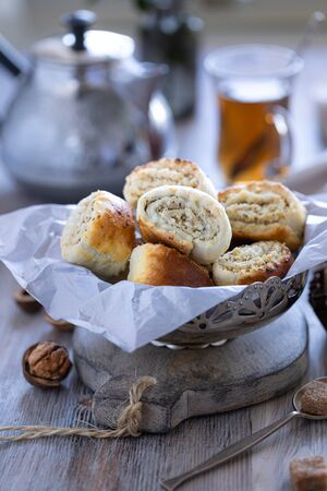 Oriental pastry made from puff pastry and wrapped in it a filling of sugar, butter and walnut. 写真素材 - 129478378