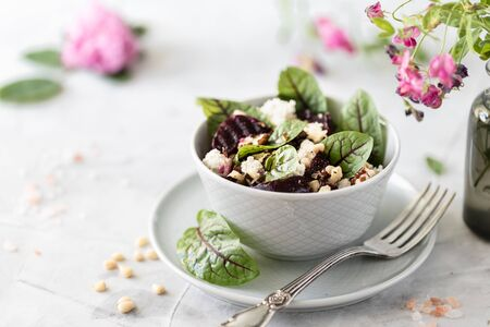 Salad of beets, cheese, green peas and pine nuts. Vegetarian salad with vegetables and fresh chard leaves. Copy space. Place for text