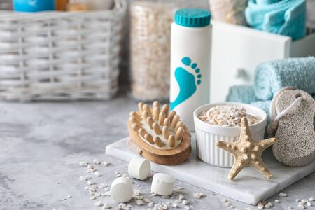 Spa accessories - sea salt, brush, powder, effervescent bath tablets, pumice, cream on a light background. Healthy lifestyle concept. Beauty, lifestyle, composition for skin care. Cosmetics for skin care feet. Decor for the bathroom. Spa set on a white background. Imagens