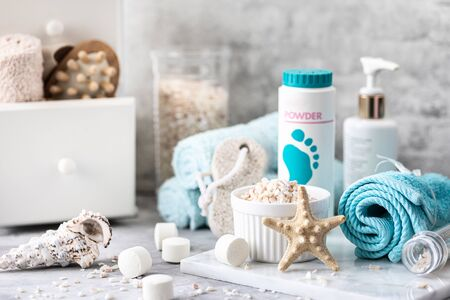 Spa accessories - sea salt, brush, powder, effervescent bath tablets, pumice, cream on a light background. Healthy lifestyle concept. Beauty, lifestyle, composition for skin care. Cosmetics for skin care feet.