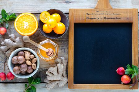 Healthy products for Immunity boosting on wooden background with copy space top view. Lemon, nuts, ginger to immune system.
