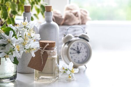 Spa resort at home with tea made of jasmine flowers on a white background. Copy space. Spa and wellness concept