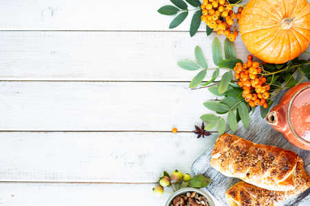 Autumn background. Apples, pumpkin, apples of paradise, rowan on a white wooden background. Harvesting. Top view. Copy space