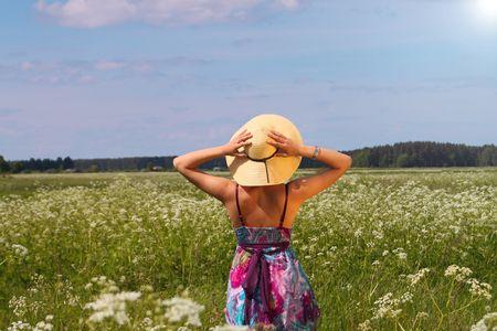Young woman in summer hat enjoying nature  photo