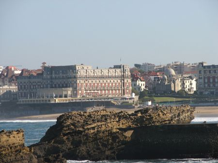 napoleon iii: view of the luxury Hotel du Palais in Biarritz and the sea behind the rocks. This Hotel was the house of Napoleon III and the emperess Eugenia