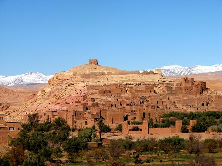 ksar of Ait Ben Adou with snowed mountains in the background photo