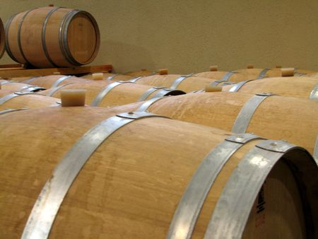 winemaker: close-up of wine barrels in a cellar