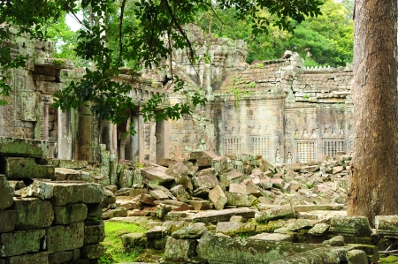 Ruin of Temple in Angkor Thom in the Jungle of Cambodia photo